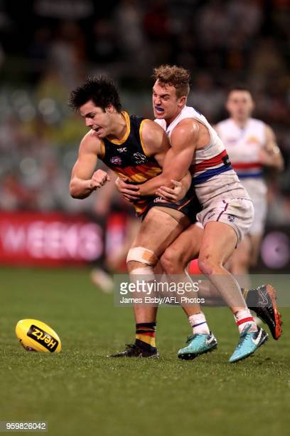 Darcy Fogarty of the Crows is tackled by Mitch Wallis of the Bulldogs during the 2018 AFL round nine match between the Adelaide Crows and the Western...