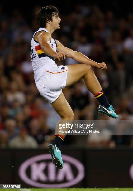 Darcy Fogarty of the Crows kicks his first league goal during the 2018 AFL round 01 match between the Essendon Bombers and the Adelaide Crows at...