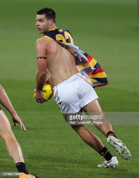 Darcy Fogarty of the Crows kicks the ball during the 2020 AFL Round 02 match between the Port Adelaide Power and the Adelaide Crows at Adelaide Oval...