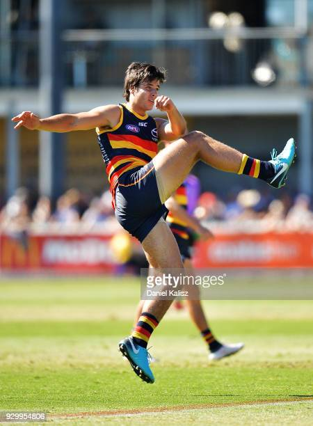 Darcy Fogarty of the Crows kicks the ball during the JLT Community Series AFL match between Port Adelaide Power and the Adelaide Crows at Alberton...