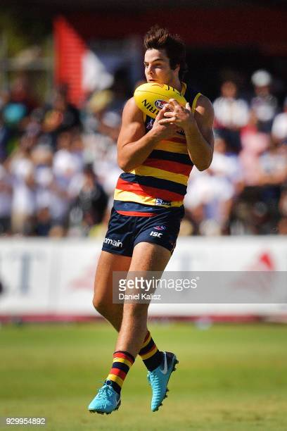 Darcy Fogarty of the Crows marks the ball during the JLT Community Series AFL match between Port Adelaide Power and the Adelaide Crows at Alberton...