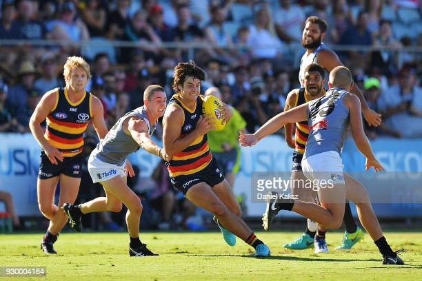 Darcy Fogarty of the Crows runs with the ball during the JLT Community Series AFL match between Port Adelaide Power and the Adelaide Crows at...
