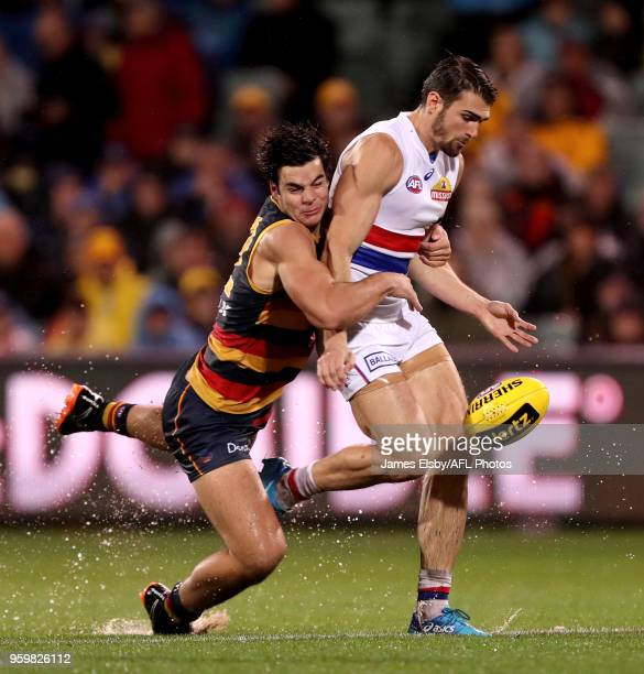 Darcy Fogarty of the Crows tackles Easton Wood of the Bulldogs during the 2018 AFL round nine match between the Adelaide Crows and the Western...