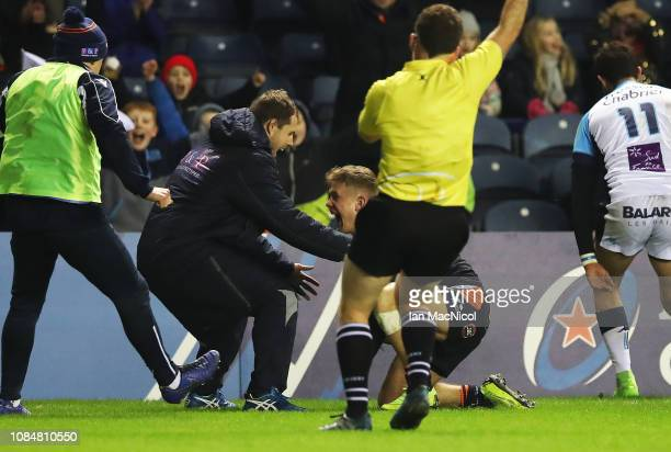 Darcy Graham of Edinburgh Rugby celebrates after scoring his side's only try during the Champions Cup match between Edinburgh Rugby and Montpellier...