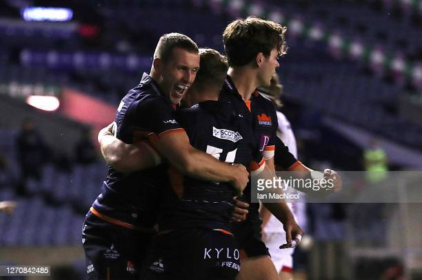 Darcy Graham of Edinburgh Rugby is congratulated by Mark Bennett after he scores his side's second try during the Guinness PRO14 PlayOff Semi Final...