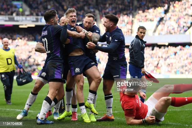 Darcy Graham of Scotland celebrates scoring his sides first try with his team mates during the Guinness Six Nations match between Scotland and Wales...