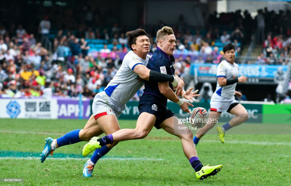 Darcy Graham (R) of Scotland is tackled during their match against South Korea on the second day of the Hong Kong Sevens on April 7, 2018 in Hong Kong.