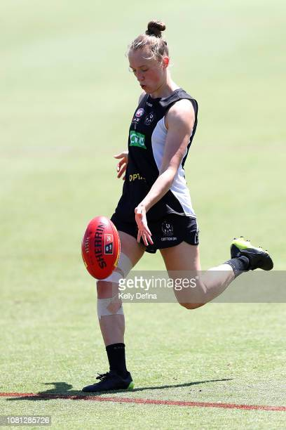 Darcy Guttridge of the Magpies kicks the ball during a Collingwood Magpies AFLW and AFL team training session at the Holden Centre on December 12...