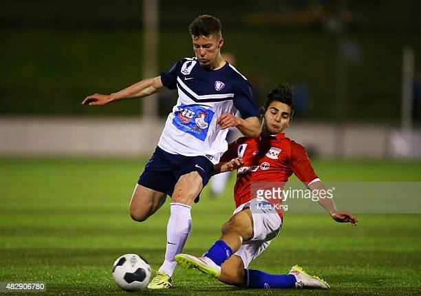 Darcy Hall of South Hobart is challenged by Guiseppe Camera of Sydney United during the FFA Cup match between Sydney United 58 FC and South Hobart at...