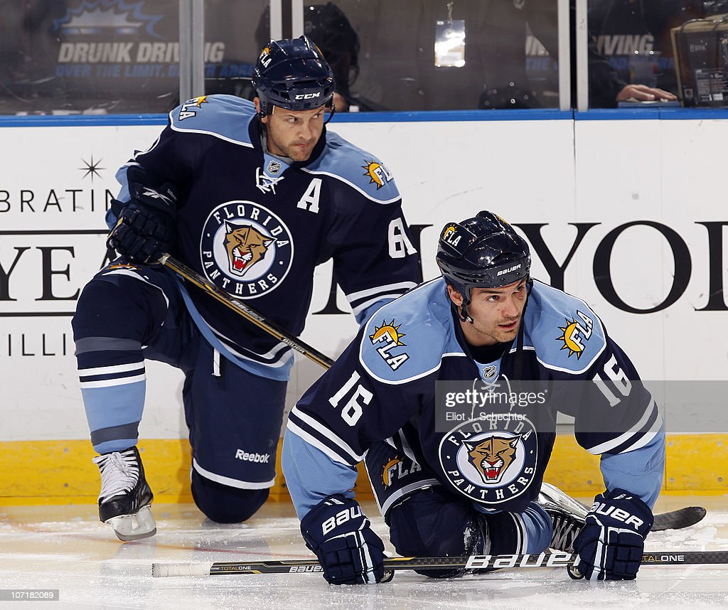 Darcy Hordichuk Of The Florida Panthers And Teammate Cory