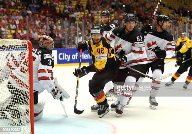 Darcy Kuemper of Team Canada Yasin Ehliz of Team Germany and Bo Horvat of Team Canada during the IIHF World Championship game between Canada and...