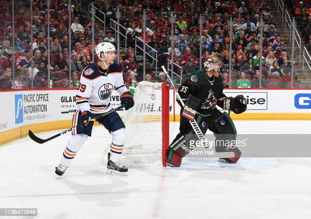 Darcy Kuemper of the Arizona Coyotes gets ready to make a save as Alex Chiasson of the Edmonton Oilers looks for the puck at Gila River Arena on...