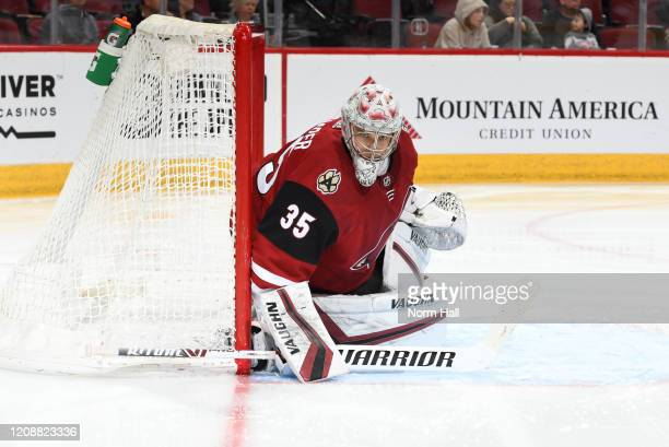 Darcy Kuemper of the Arizona Coyotes gets ready to make a save against the Florida Panthers at Gila River Arena on February 25 2020 in Glendale...