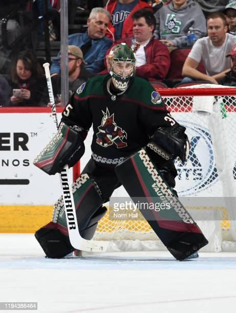 Darcy Kuemper of the Arizona Coyotes looks to make a save against the New Jersey Devils at Gila River Arena on December 14, 2019 in Glendale, Arizona.