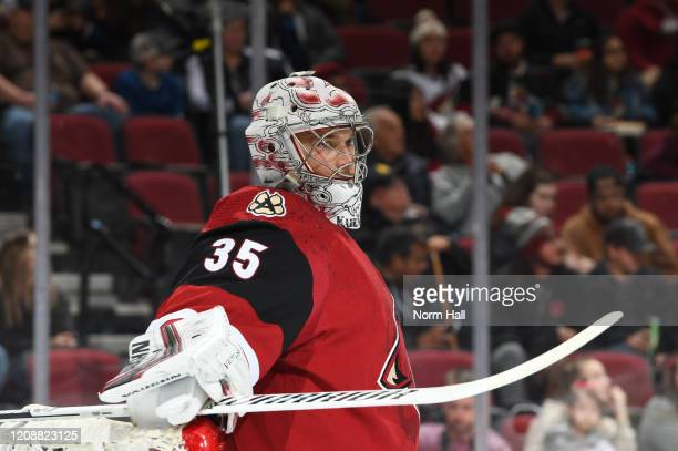 Darcy Kuemper of the Arizona Coyotes looks up ice during a stop in play against the Florida Panthers at Gila River Arena on February 25 2020 in...