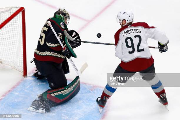 Darcy Kuemper of the Arizona Coyotes makes the second period stop on Gabriel Landeskog of the Colorado Avalanche in Game Three of the Western...