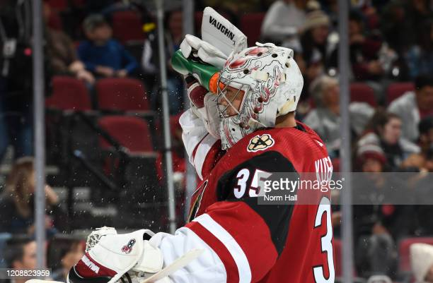 Darcy Kuemper of the Arizona Coyotes sprays water in his face during a stop in play against the Florida Panthers at Gila River Arena on February 25...