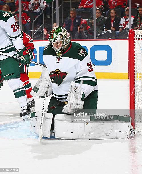Darcy Kuemper of the Minnesota Wild defends his net during the game against the New Jersey Devils at the Prudential Center on March 17 2016 in Newark...