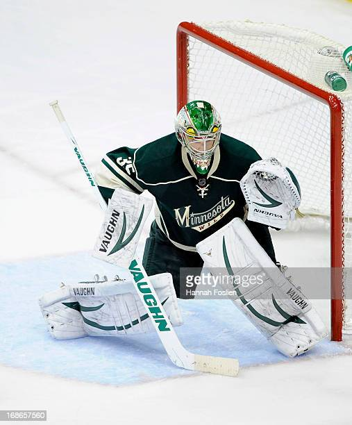 Darcy Kuemper of the Minnesota Wild defends the net in Game Four of the Western Conference Quarterfinals against the Chicago Blackhawks during the...