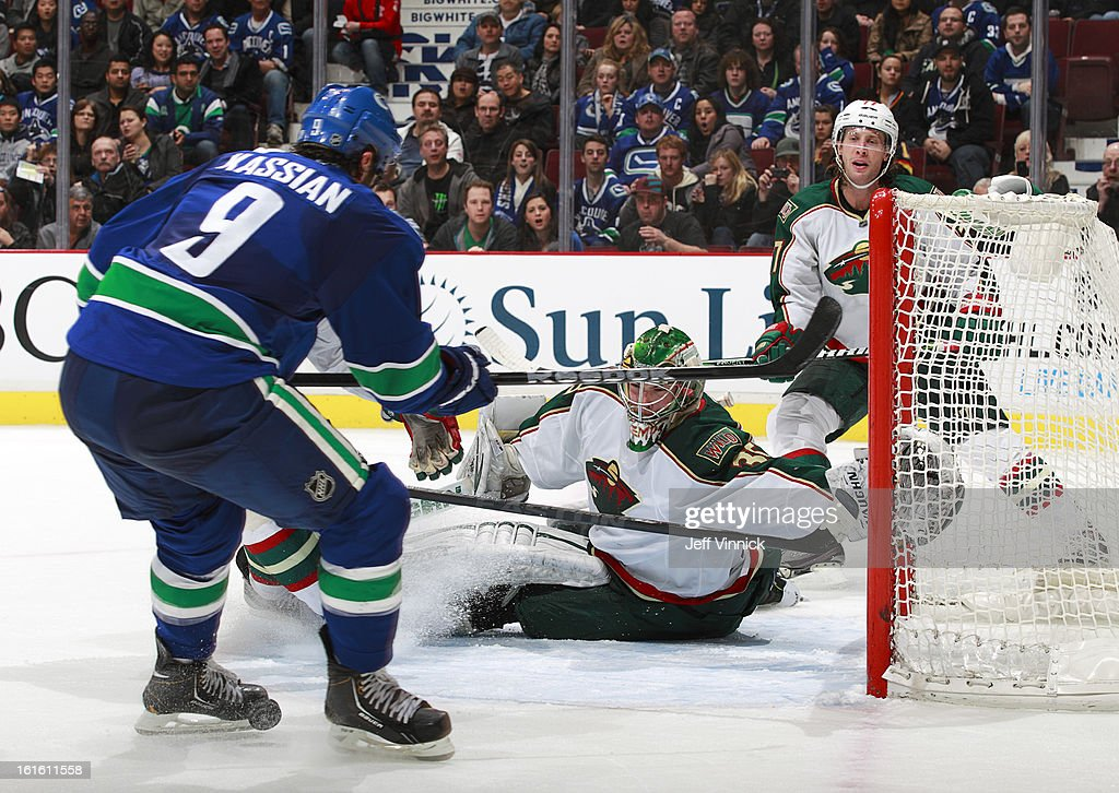 Darcy Kuemper #35 of the Minnesota Wild makes a save off the shot of Zack Kassian #9 of the Vancouver Canucks during their NHL game at Rogers Arena February 12, 2013 in Vancouver, British Columbia, Canada. Vancouver won 2-1