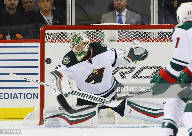 Darcy Kuemper of the Minnesota Wild tends net against the New York Islanders at the Barclays Center on October 23 2016 in the Brooklyn borough of New...