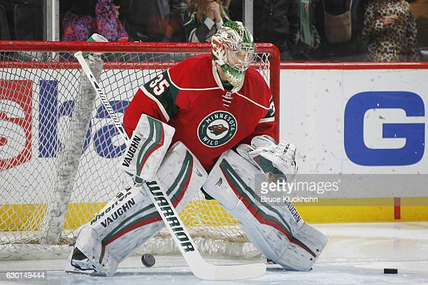 Darcy Kuemper of the Minnesota Wild warms up prior to the game against the Arizona Coyotes on December 17 2016 at the Xcel Energy Center in St Paul...