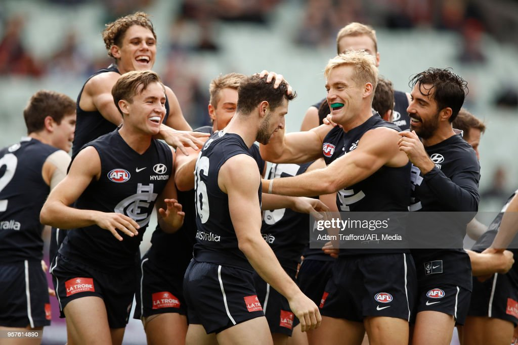 Darcy Lang of the Blues celebrates his first goal as a blue with teammates during the 2018 AFL round eight match between the Carlton Blues and the Essendon Bombers at the Melbourne Cricket Ground on May 12, 2018 in Melbourne, Australia.