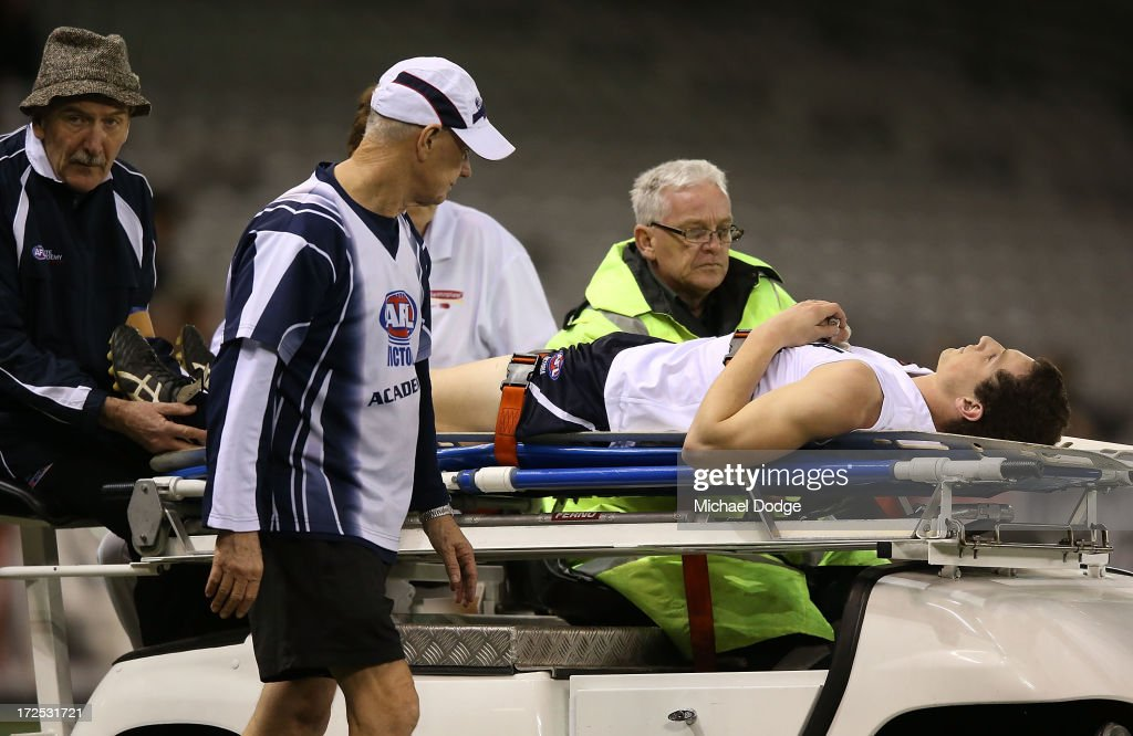 Darcy Lang of Vic Country gets taken off with a leg injury during the AFL Under 18s Championship match between Victoria Country and Victoria Metro at Etihad Stadium on July 3, 2013 in Melbourne, Australia.