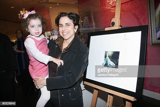 Darcy Miller Nussbaum , Editorial Director of Martha Stewart Weddings and her daughter Daisy Nussbaum, 4 yrs old, attend Reem Acra's signing of her...