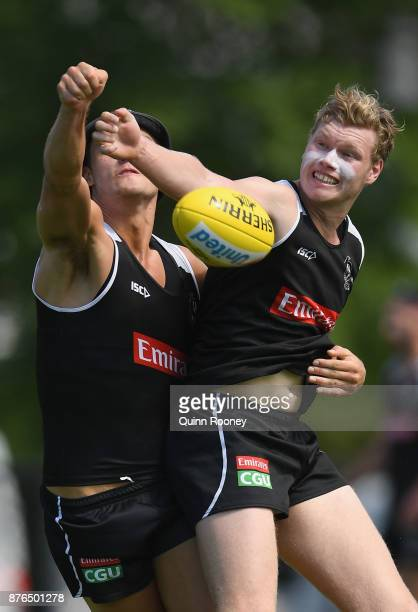 Darcy Moore and Sam McLarty of the Magpies compete for a mark during a Collingwood Magpies AFL training session at Holden Centre on November 20 2017...