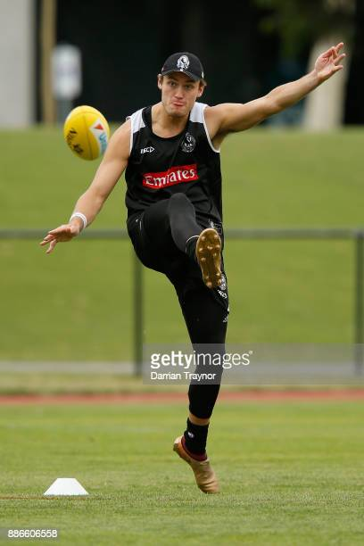 Darcy Moore kicks the ball during a Collingwood Magpies men's and women's joint AFL preseason training session at the Holden Centre on December 6...