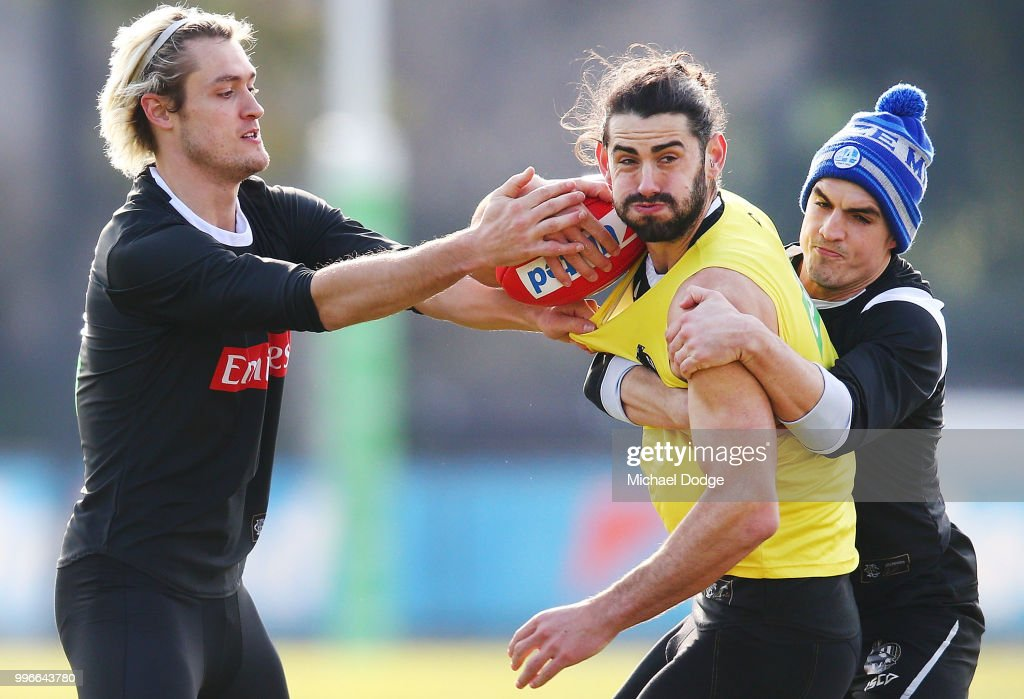 Darcy Moore of the Magpies (L) and Brayden Maynard tackle Brodie Grundy of the Magpies during a Collingwood Magpies AFL press conference at the Holden Centre on July 12, 2018 in Melbourne, Australia.