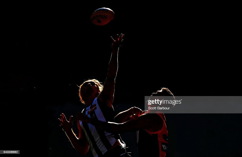 Darcy Moore of the Magpies and Jonathon Patton of the Giants compete for the ball during the round two AFL match between the Collingwood Magpies and the Greater Western Sydney Giants at Melbourne Cricket Ground on March 31, 2018 in Melbourne, Australia.
