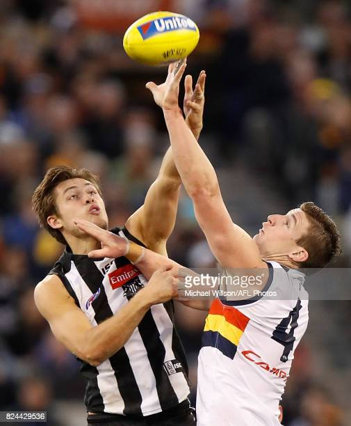 Darcy Moore of the Magpies and Josh Jenkins of the Crows compete for the ball during the 2017 AFL round 19 match between the Collingwood Magpies and...