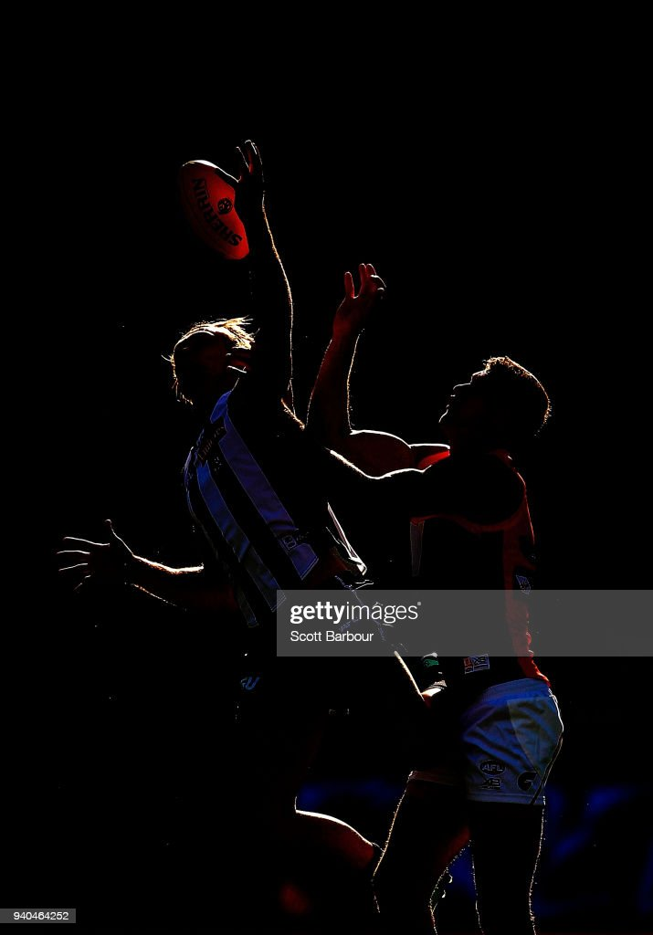 Darcy Moore of the Magpies and Rory Lobb of the Giants compete for the ball during the round two AFL match between the Collingwood Magpies and the Greater Western Sydney Giants at Melbourne Cricket Ground on March 31, 2018 in Melbourne, Australia.