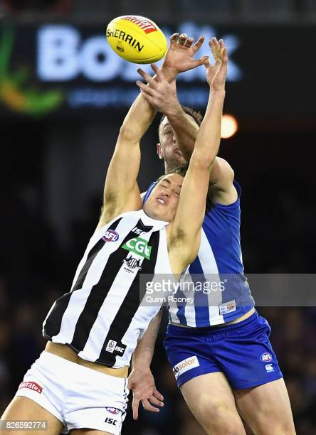 Darcy Moore of the Magpies and Todd Goldstein of the Kangaroos compete for a mark during the round 20 AFL match between the North Melbourne Kangaroos...