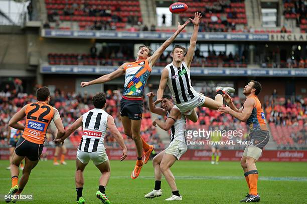 Darcy Moore of the Magpies flies for the ball during the round 14 AFL match between the Greater Western Sydney Giants and the Carlton Blues at...