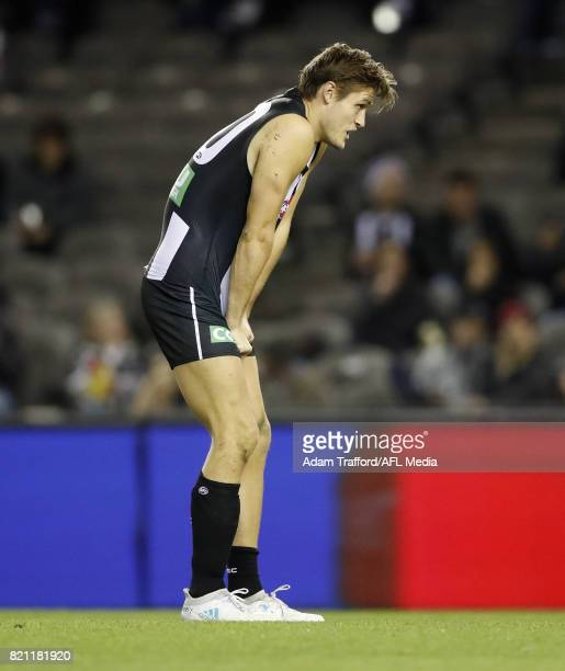 Darcy Moore of the Magpies gets up slowly after a big hit during the 2017 AFL round 18 match between the Collingwood Magpies and the West Coast...