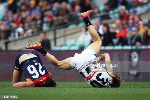 Darcy Moore of the Magpies is challenged by Sam Weideman of the Demons during the round 13 AFL match between the Melbourne Demons and the Collingwood...