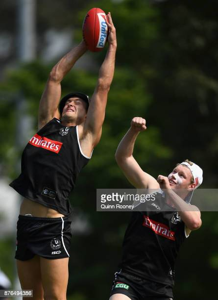 Darcy Moore of the Magpies marks infront of Sam McLarty during a Collingwood Magpies AFL training session at Holden Centre on November 20 2017 in...