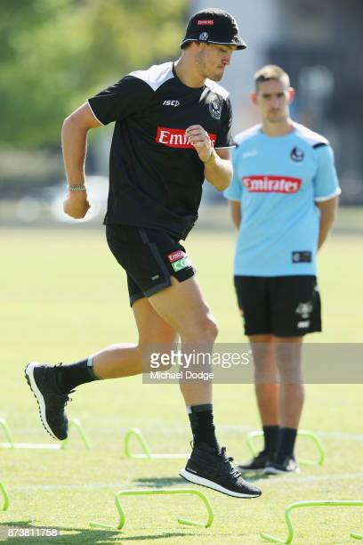 Darcy Moore of the Magpies punches hops over obstacles during a Collingwood Magpies AFL training session on November 14 2017 in Melbourne Australia