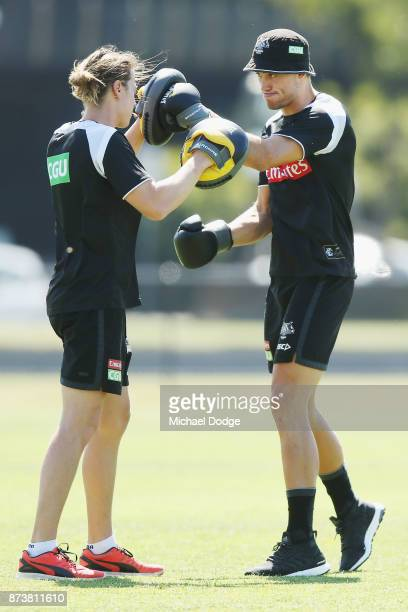 Darcy Moore of the Magpies punches with the gloves during a Collingwood Magpies AFL training session on November 14 2017 in Melbourne Australia