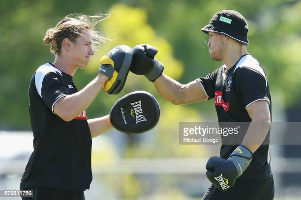 Darcy Moore of the Magpies punches with the gloves with Tom Langdon during a Collingwood Magpies AFL training session on November 14 2017 in...