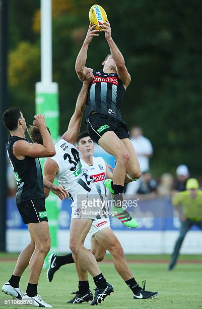 Darcy Moore of the Magpies takes a high mark during the Collingwood Magpies AFL Intraclub match at Olympic Park on February 18 2016 in Melbourne...