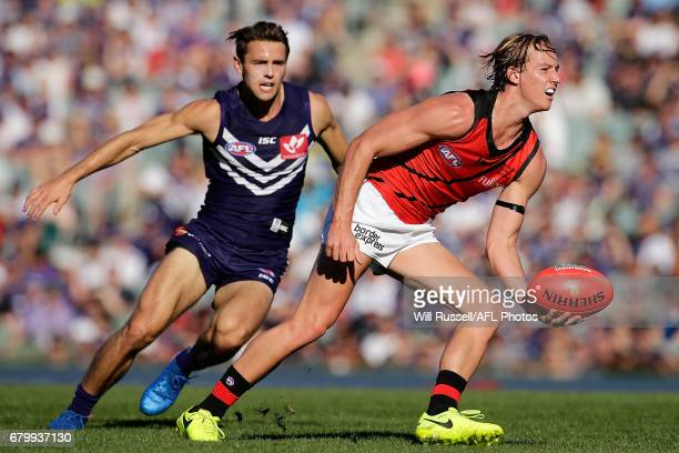 Darcy Parish of the Bombers handpasses the ball during the round seven AFL match between the Fremantle Dockers and the Essendon Bombers at Domain...