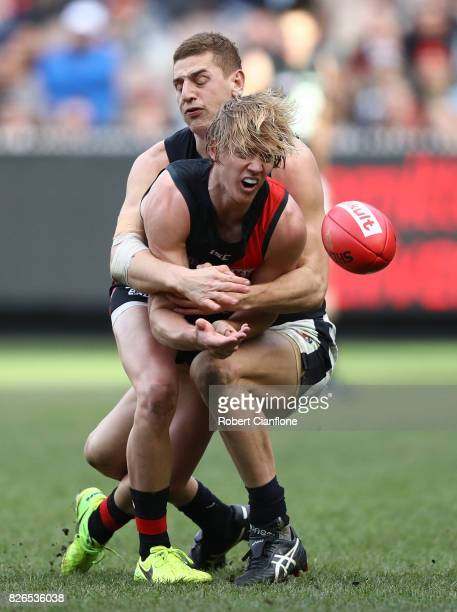 Darcy Parish of the Bombers is challenged by Liam Jones of the Blues during the round 20 AFL match between the Essendon Bombers and the Carlton Blues...