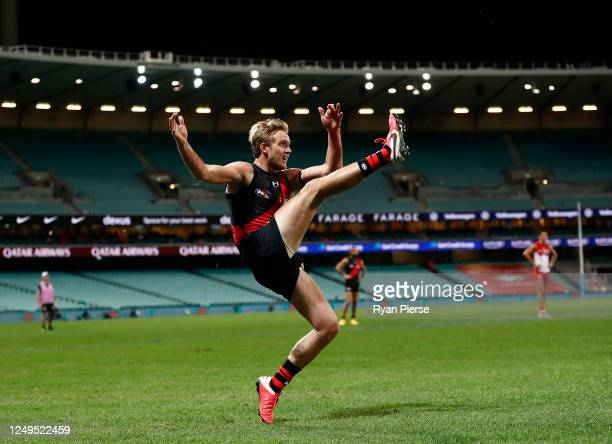 Darcy Parish of the Bombers kicks the winning goal during the round 2 AFL match between the Sydney Swans and the Essendon Bombers at Sydney Cricket...