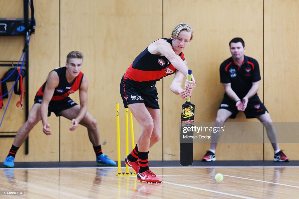 Darcy Parish of the Bombers plays a game of cricket while waiting during an Essendon Bombers team photo session at The Hangar on February 6, 2018 in Melbourne, Australia.