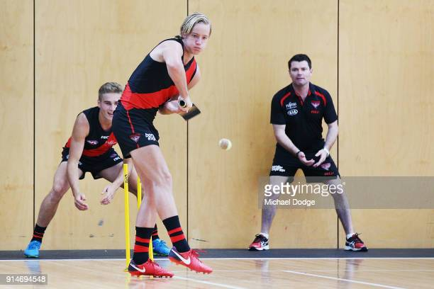 Darcy Parish of the Bombers plays a game of cricket while waiting during an Essendon Bombers team photo session at The Hangar on February 6 2018 in...
