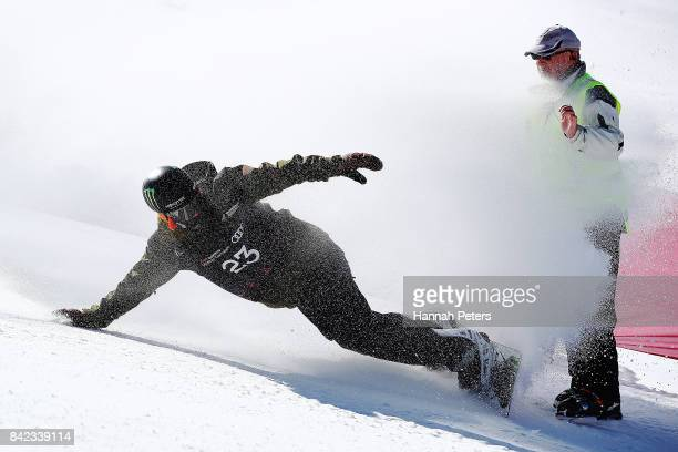 Darcy Sharpe of Canada crashes in to an official after competing in the Winter Games NZ FIS Men's Snowboard World Cup Slopestyle Finals at Cardrona...
